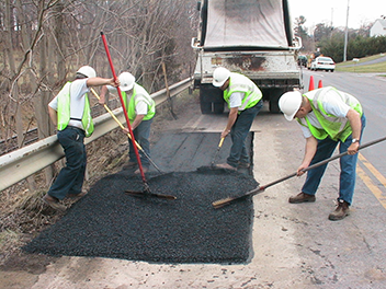 Workers pave a road